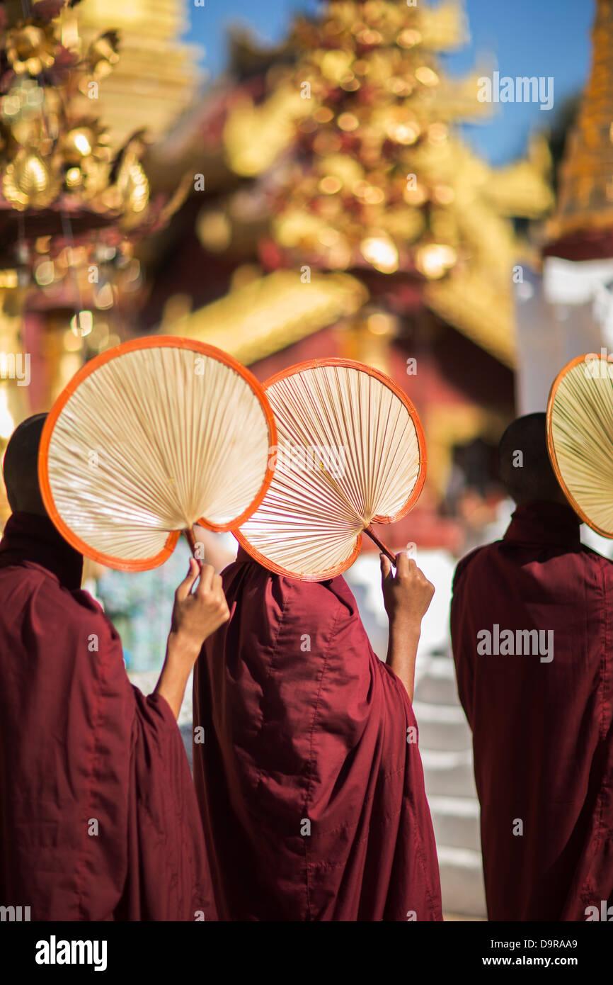 monks at the Shwezigon Paya, Bagan, Myanmar (Burma) Stock Photo