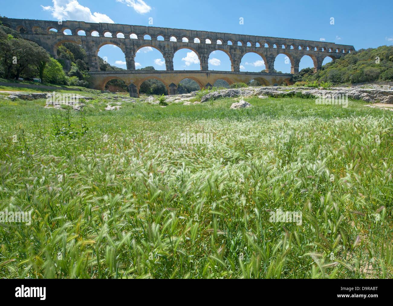UNESCO world heritage Pont du Gard, a Roman aqueduct near Nîmes in the Gard, seen from the banks of the Gardon - Stock Image
