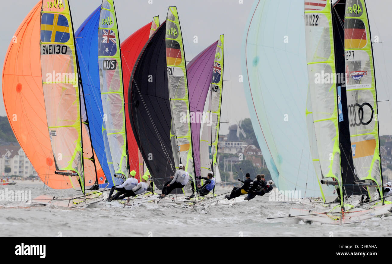 Boats of the Olympic 49er class compete in a regatta on the Baltic Sea off Kiel-Schilksee, Germany, 25 June 2013. - Stock Image