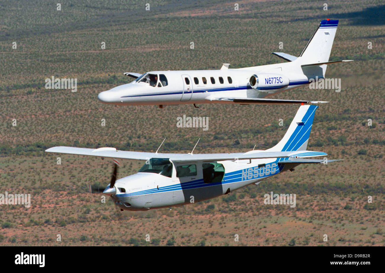 A CBP Citation jet and a Cessna plane patrol the airspace around the southern border. - Stock Image