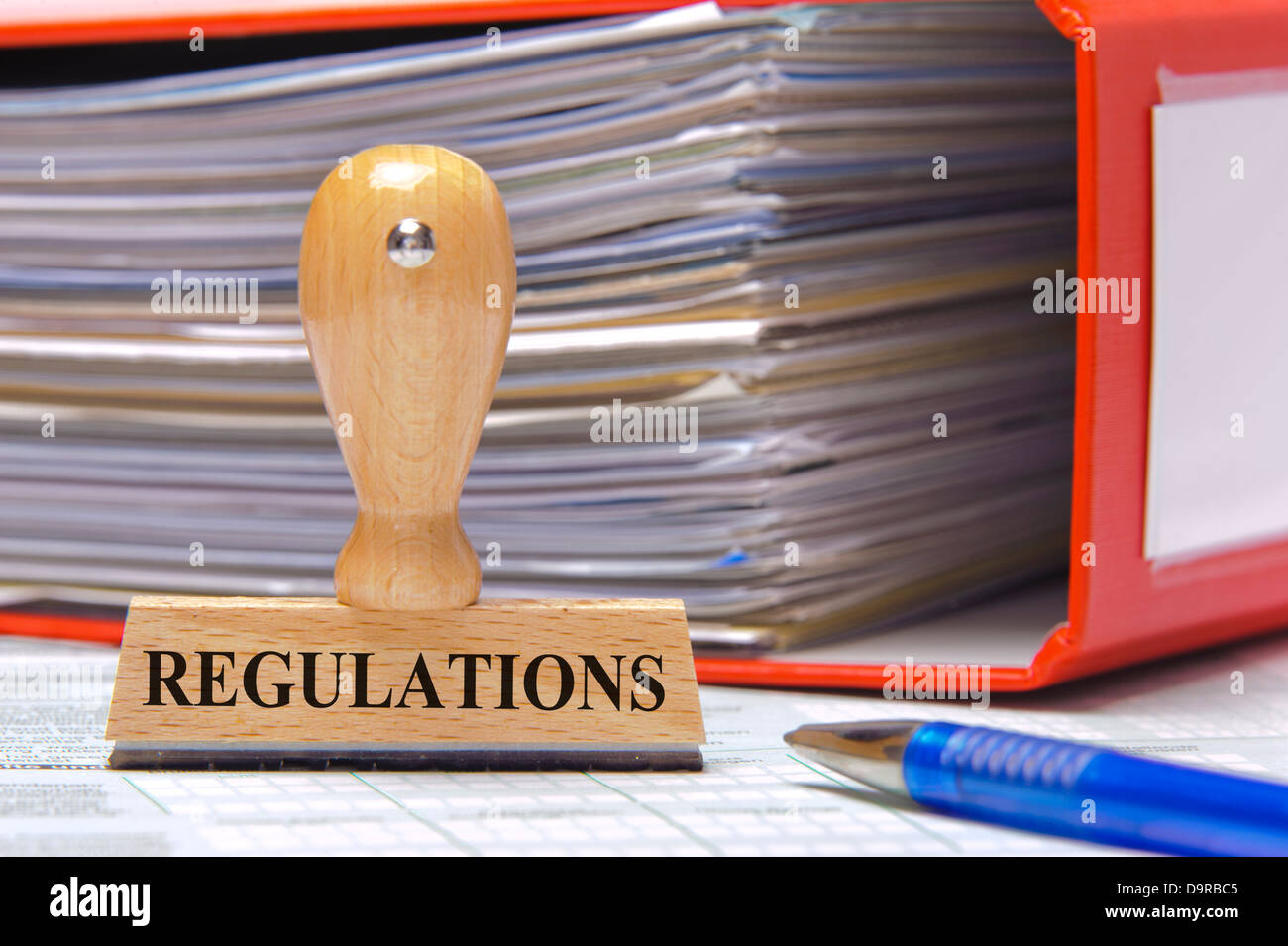 regulations marked on rubber stamp - Stock Image