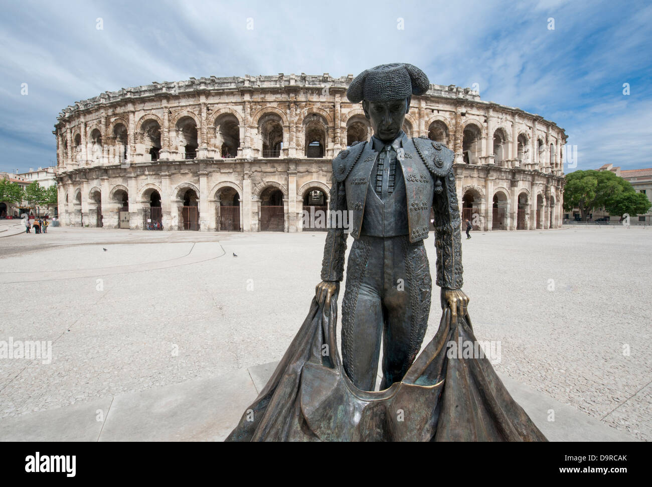 Statue of the famous bull-fighter Nimeño in front of Les Arénes, the roman amphitheatre in Nîmes, - Stock Image