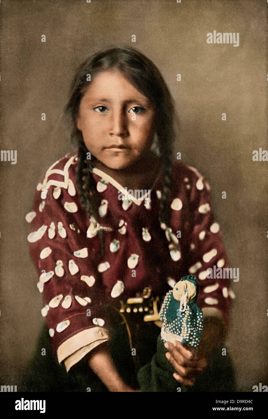 Crow Indian girl Glydis Littlenest, or Rides-a-Sorrel-Horse, circa 1900. Hand-colored halftone of a photograph - Stock Image