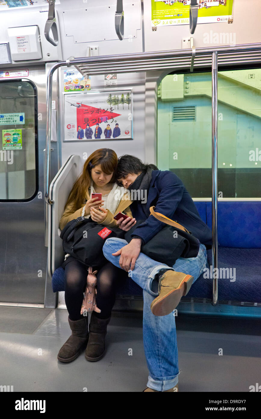 Young Couple on Tokyo Metro - Stock Image