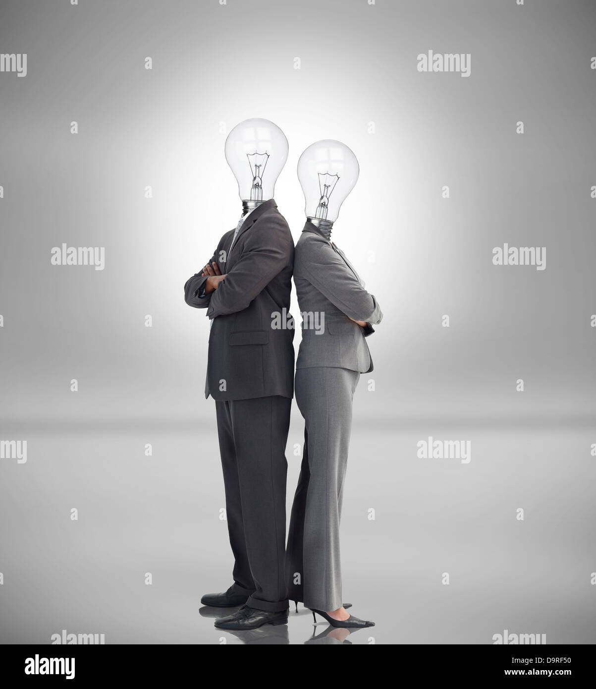 Business people with light bulbs instead of heads - Stock Image