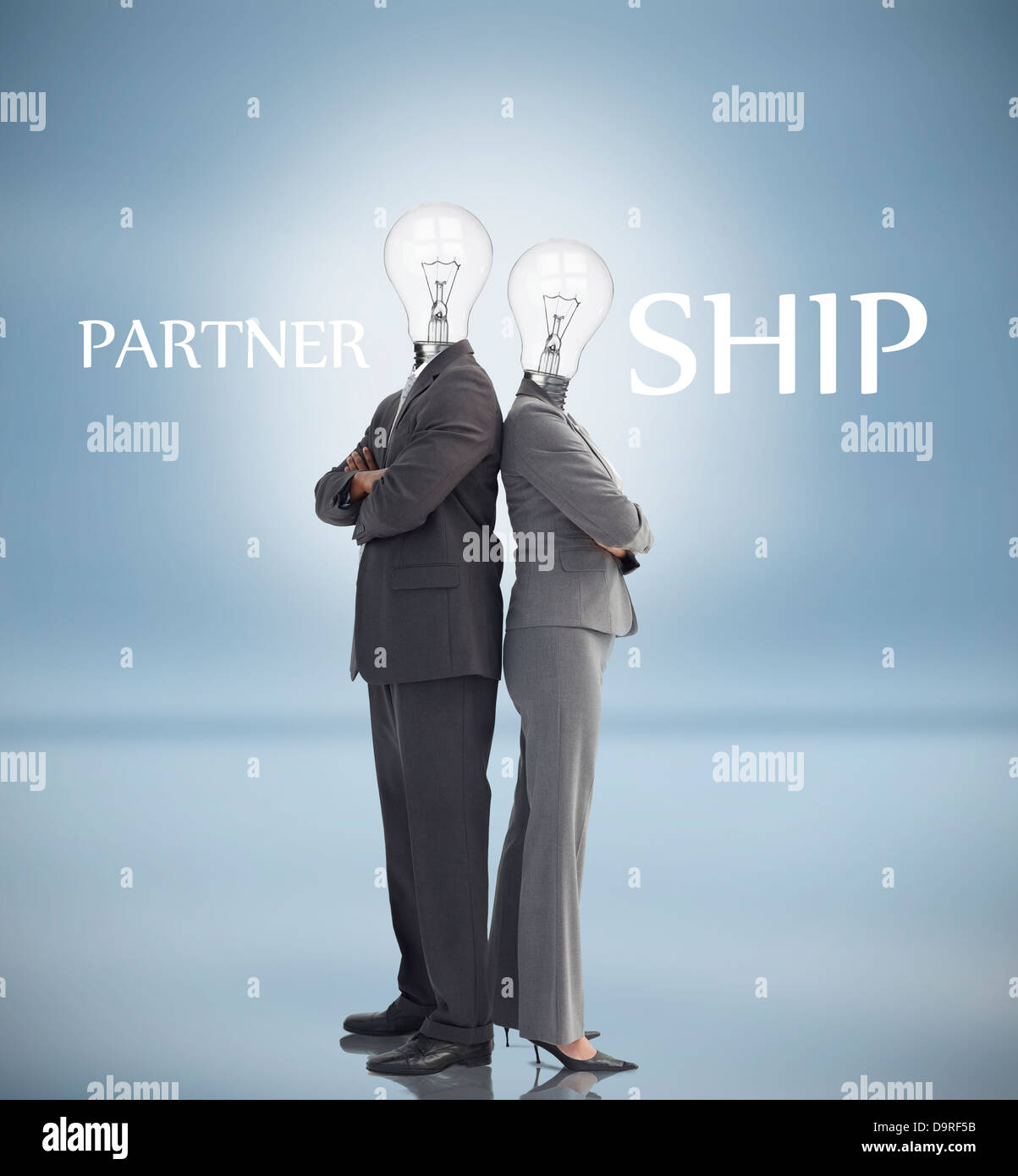 Business people with light bulbs instead of heads and partnership text - Stock Image