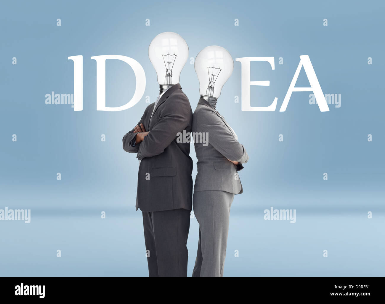Business people with light bulb heads and idea text - Stock Image