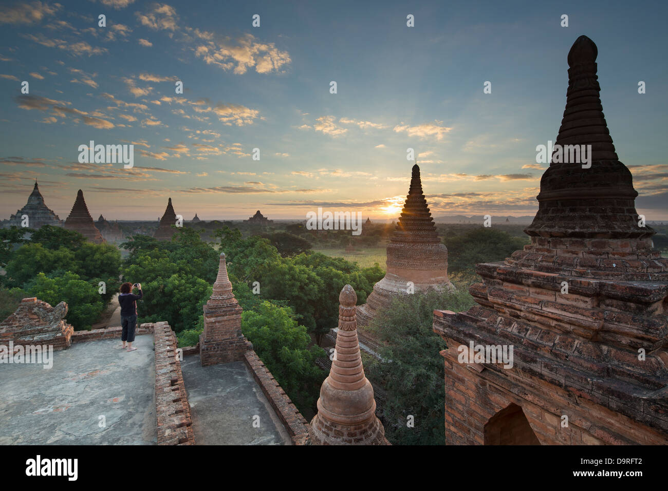 Wendy taking a picture of the Temples of Bagan at sunrise, Myanmar (Burma) Stock Photo