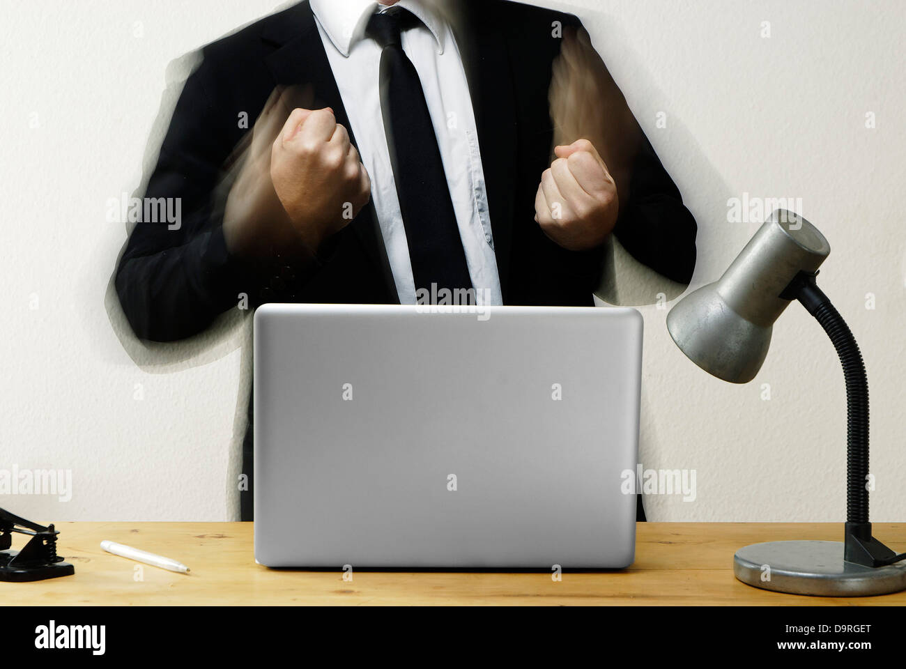Businessman with clenched fists - Stock Image