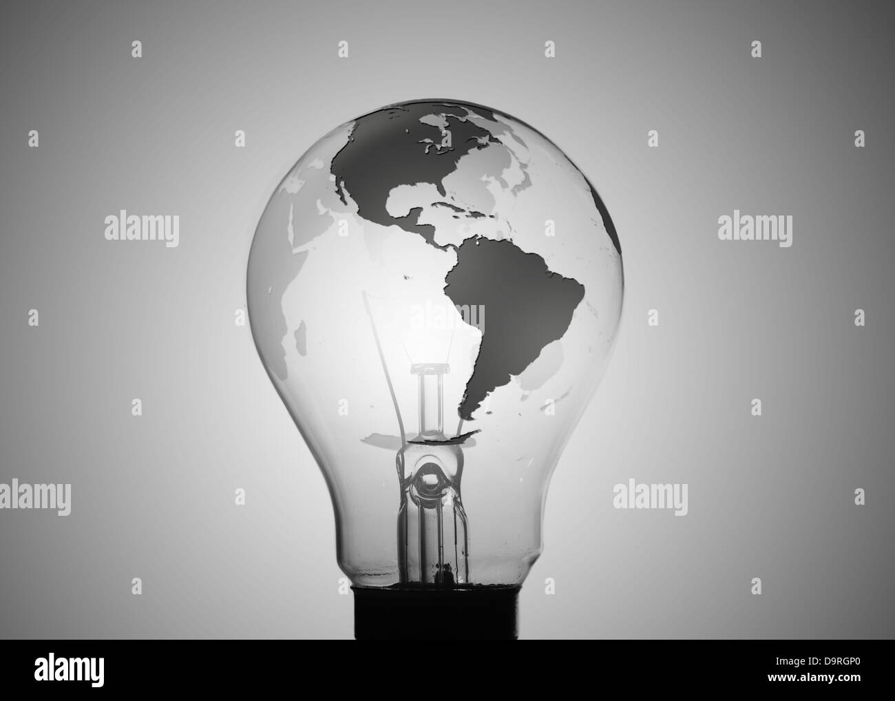 Light bulb with map of earth on its surface - Stock Image