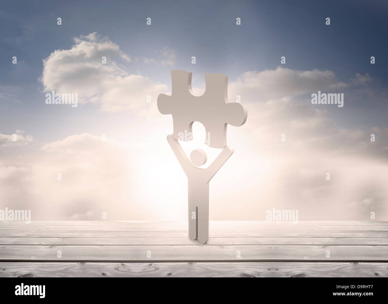 White human representation holding jigsaw piece - Stock Image