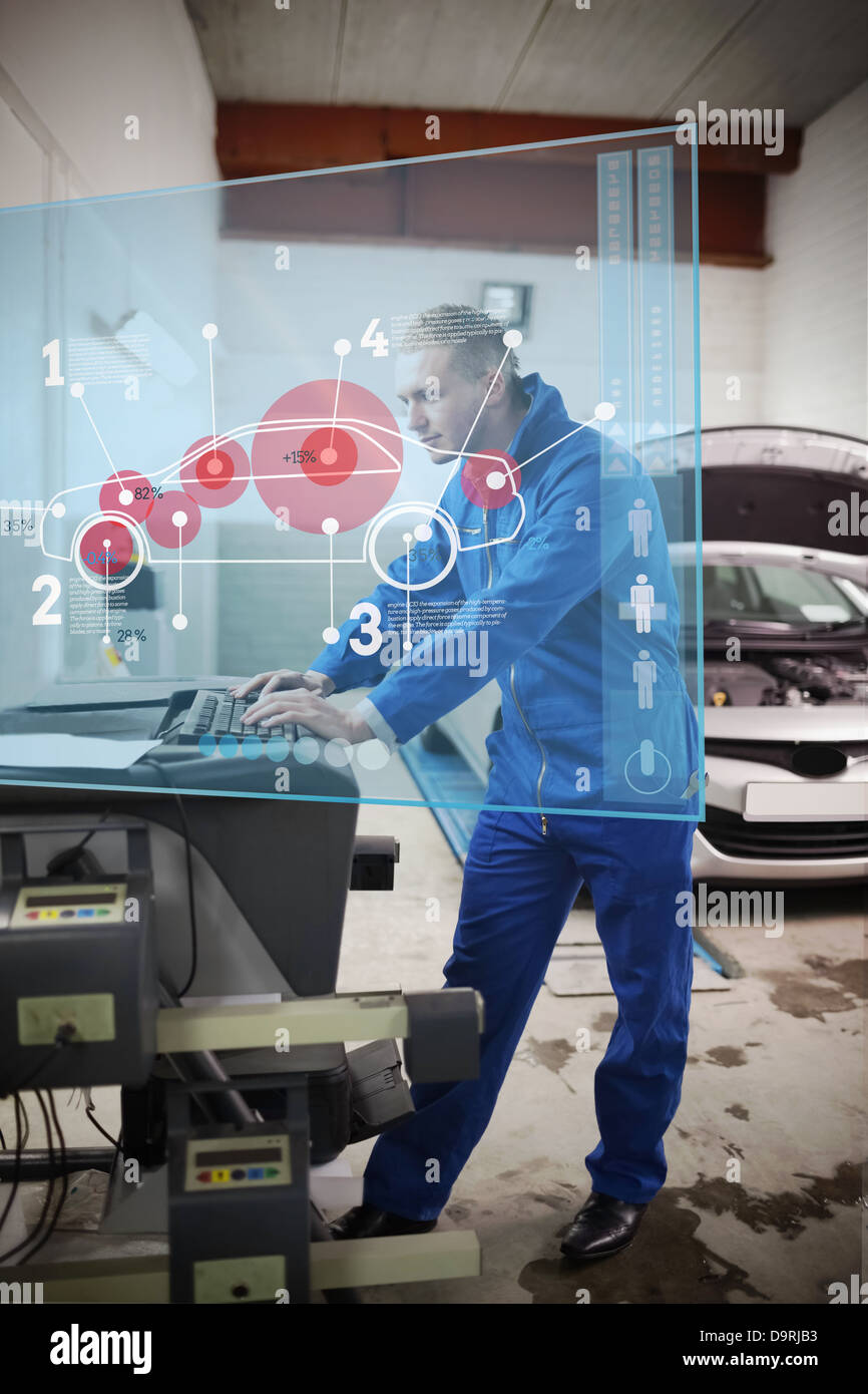Mechanic typing while consulting futuristic interface with car diagram - Stock Image
