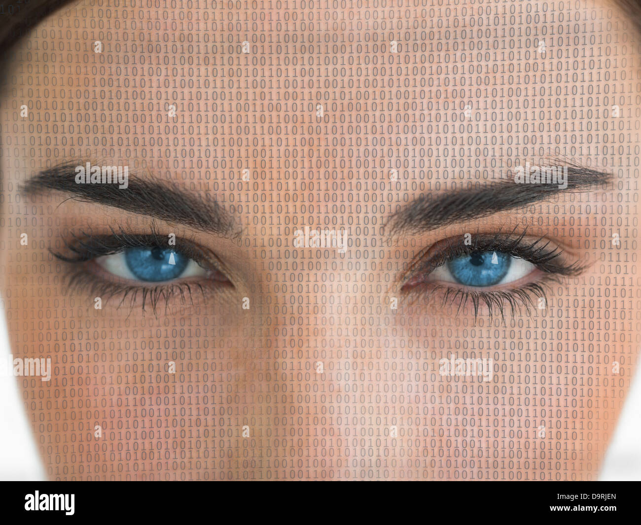 Attractive blue eyed woman with binary coding on face - Stock Image