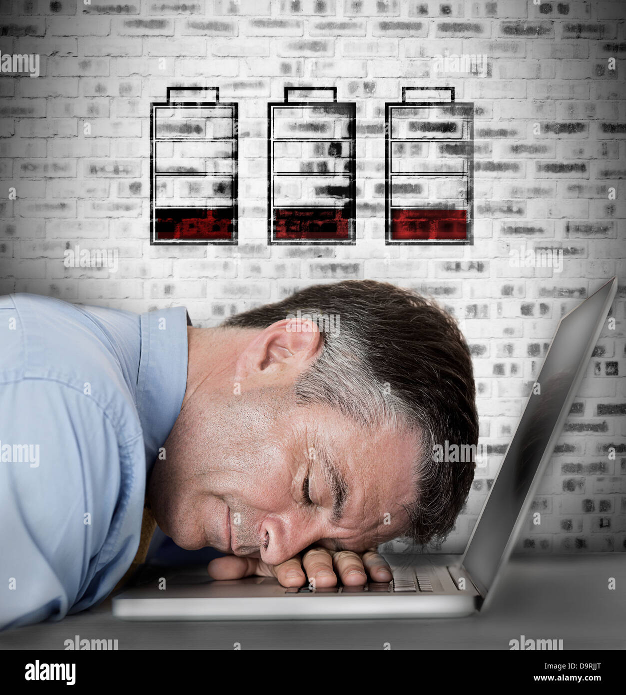 Businessman sleeping on his laptop with no battery symbols - Stock Image