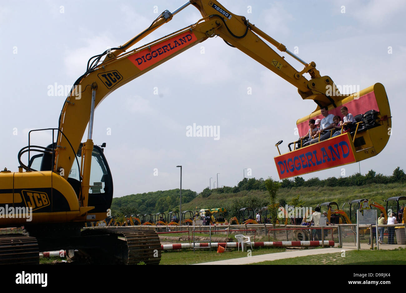 JCB racing and stunts in Diggerland Strood Kent - Stock Image