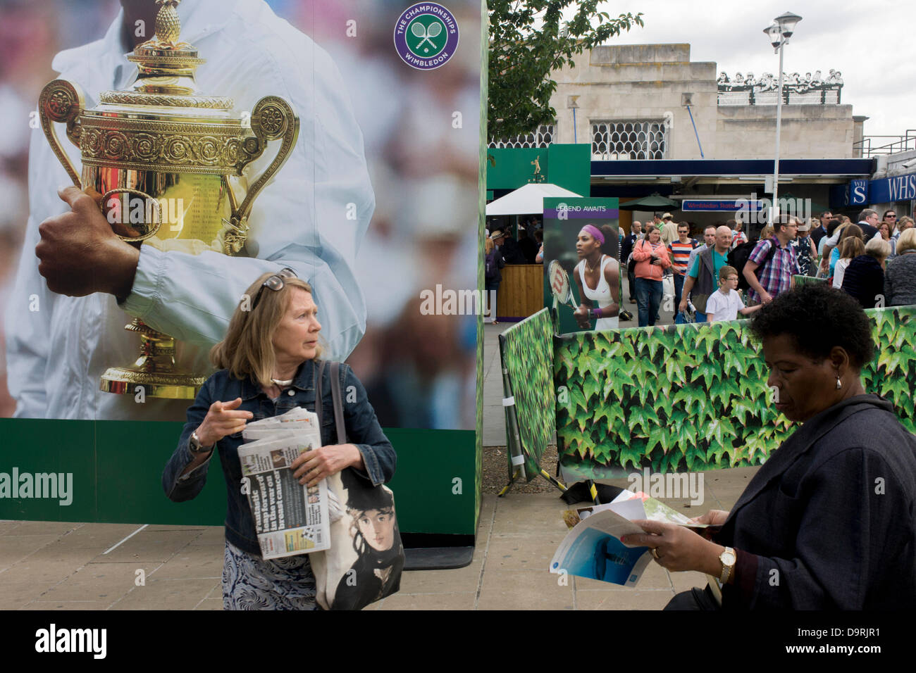 Wimbledon, England, 25th June 2013 - Day 2 of the annual lawn tennis championships and spectators mingle with locals - Stock Image