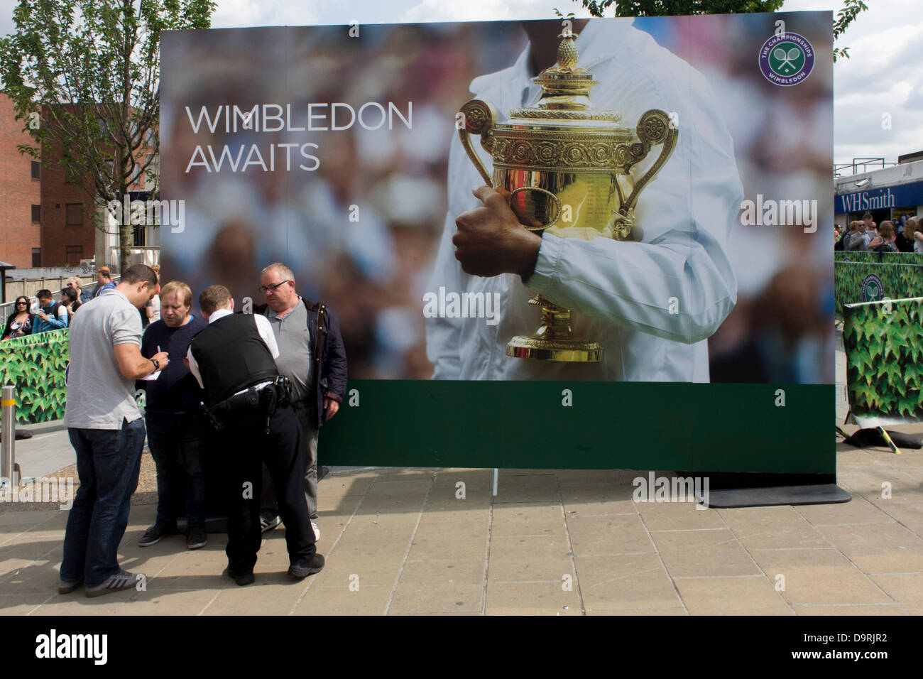 Wimbledon, England, 25th June 2013 - Day 2 of the annual lawn tennis championships and police officers question - Stock Image