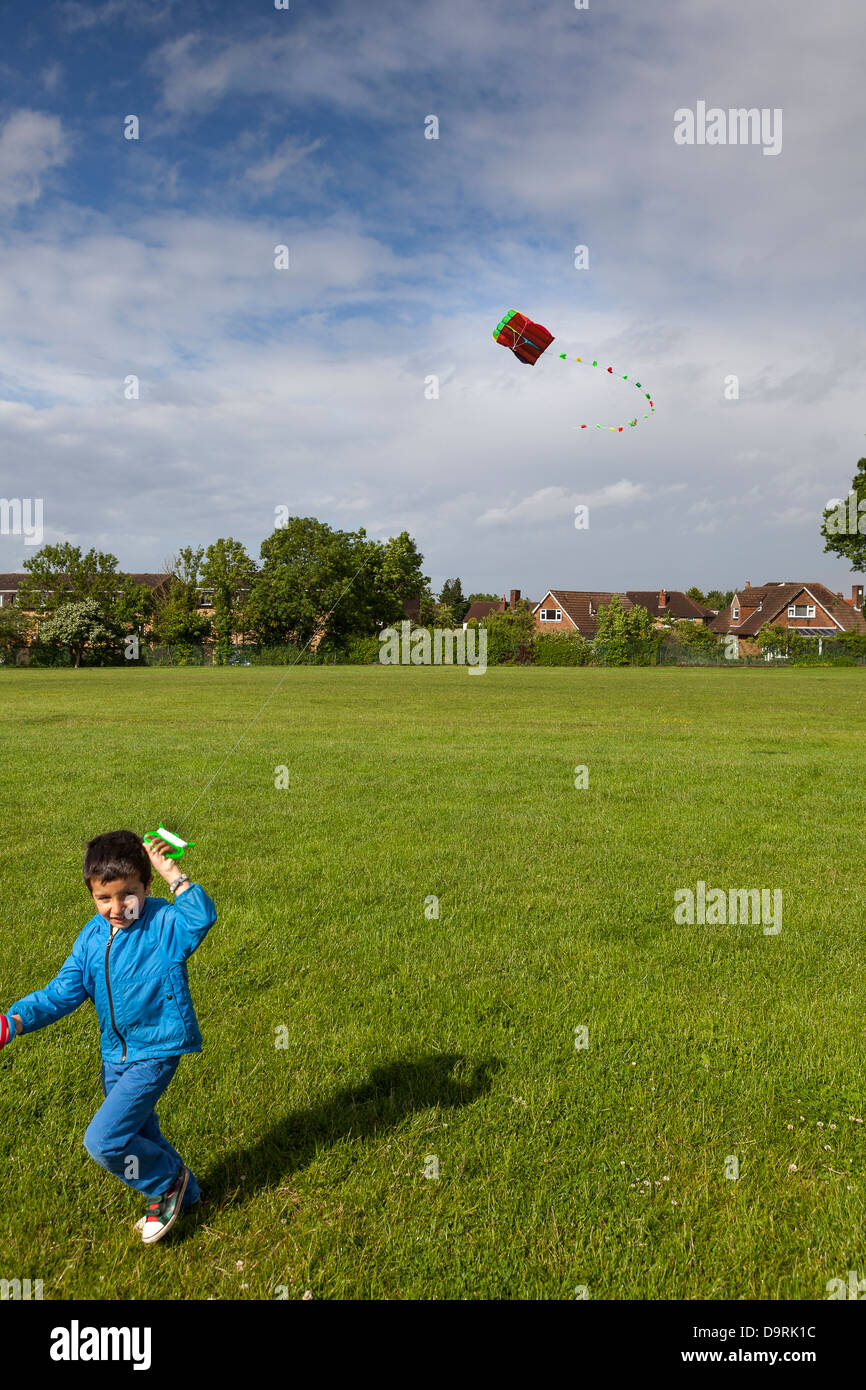 Young boy flying a kite - Stock Image