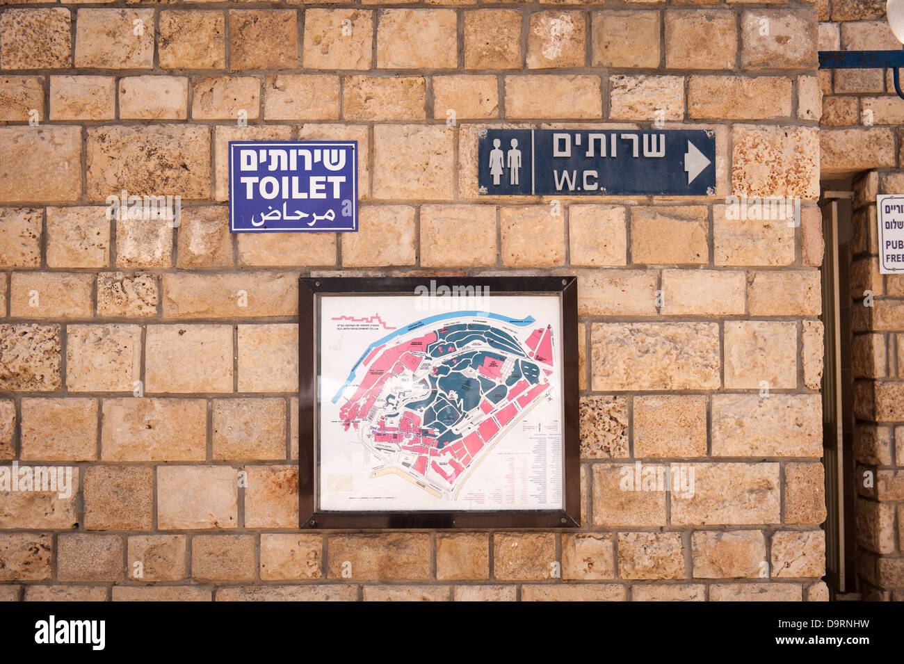 Israel Jaffa Yafo sign signs modern public conveniences WC toilet & map of old city port harbour - Stock Image