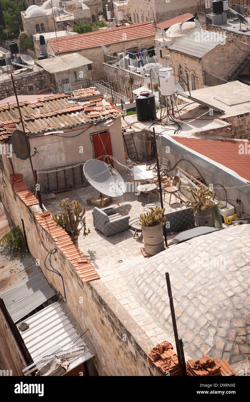 Israel Jerusalem Old City typical roof detail with solar panels satellite dish armchairs settees - Stock Image