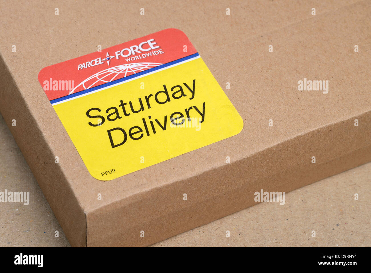 Parcel Force Saturday Delivery sticker label - Stock Image