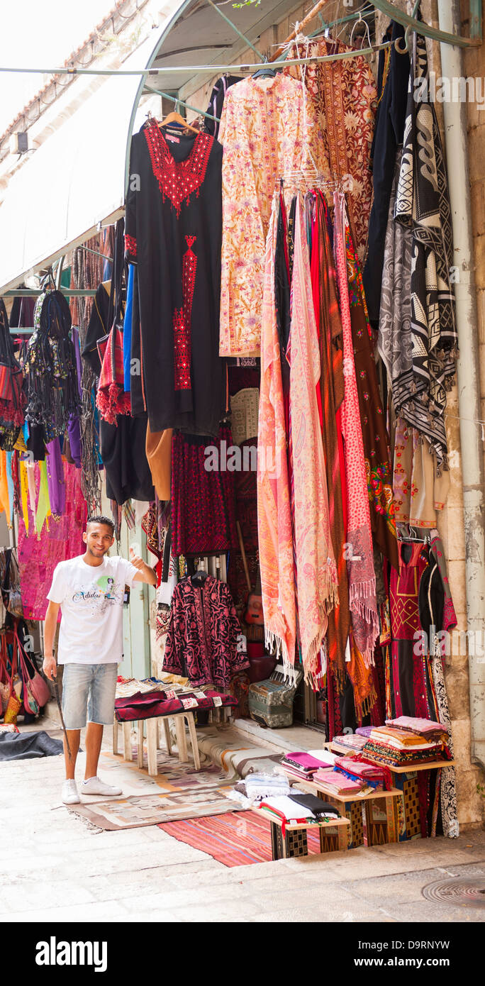 Israel Jerusalem Old City typical street scene clothes shop store hijab robes thobe thorbs abayas scarfs street - Stock Image