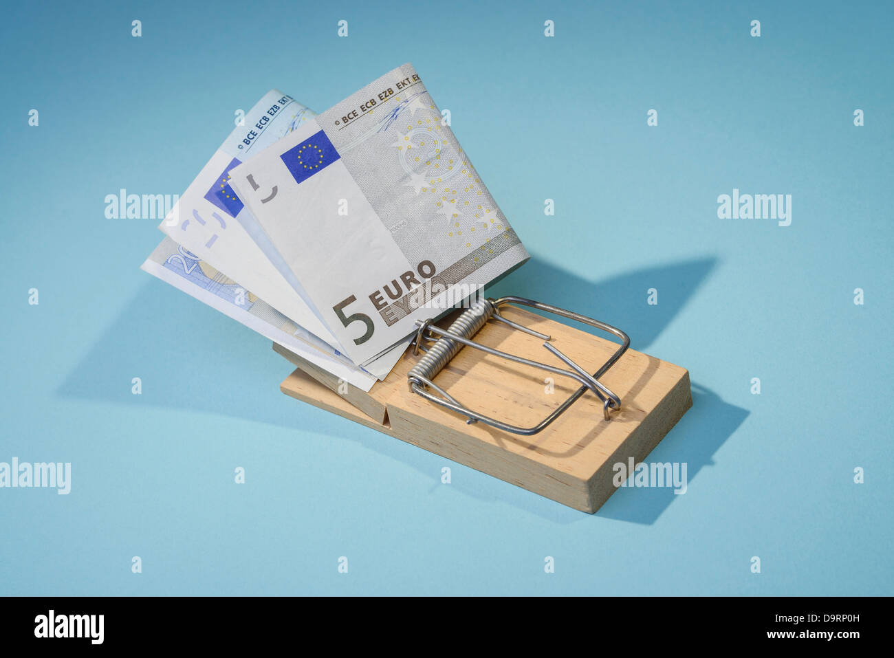 Euro notes in a mousetrap - Stock Image