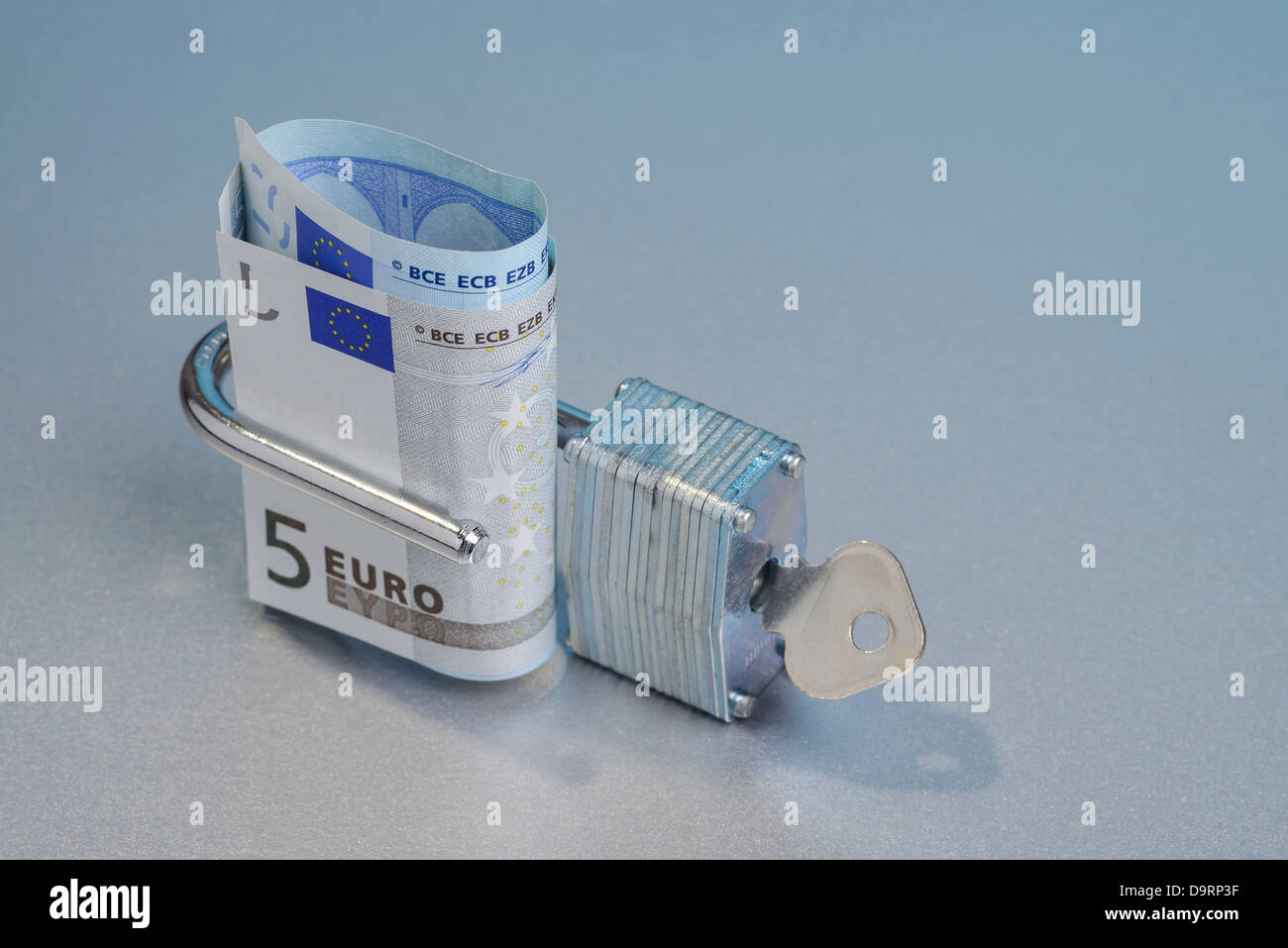 5 Euro note in an open padlock - Stock Image