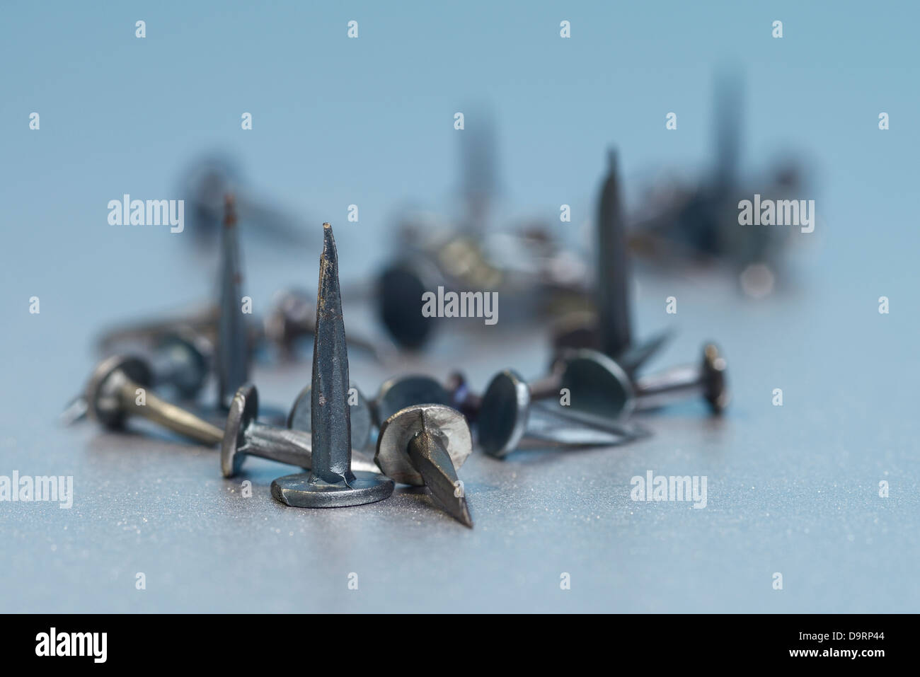 Sharp metal tacks and nails - Stock Image