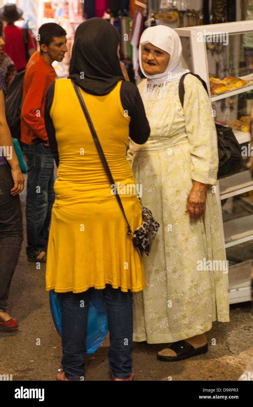 Israel Jerusalem Old City Muslim Arab Quarter Cotton Merchants' Market two 2 women ladies hijab hijabs scarf - Stock Image