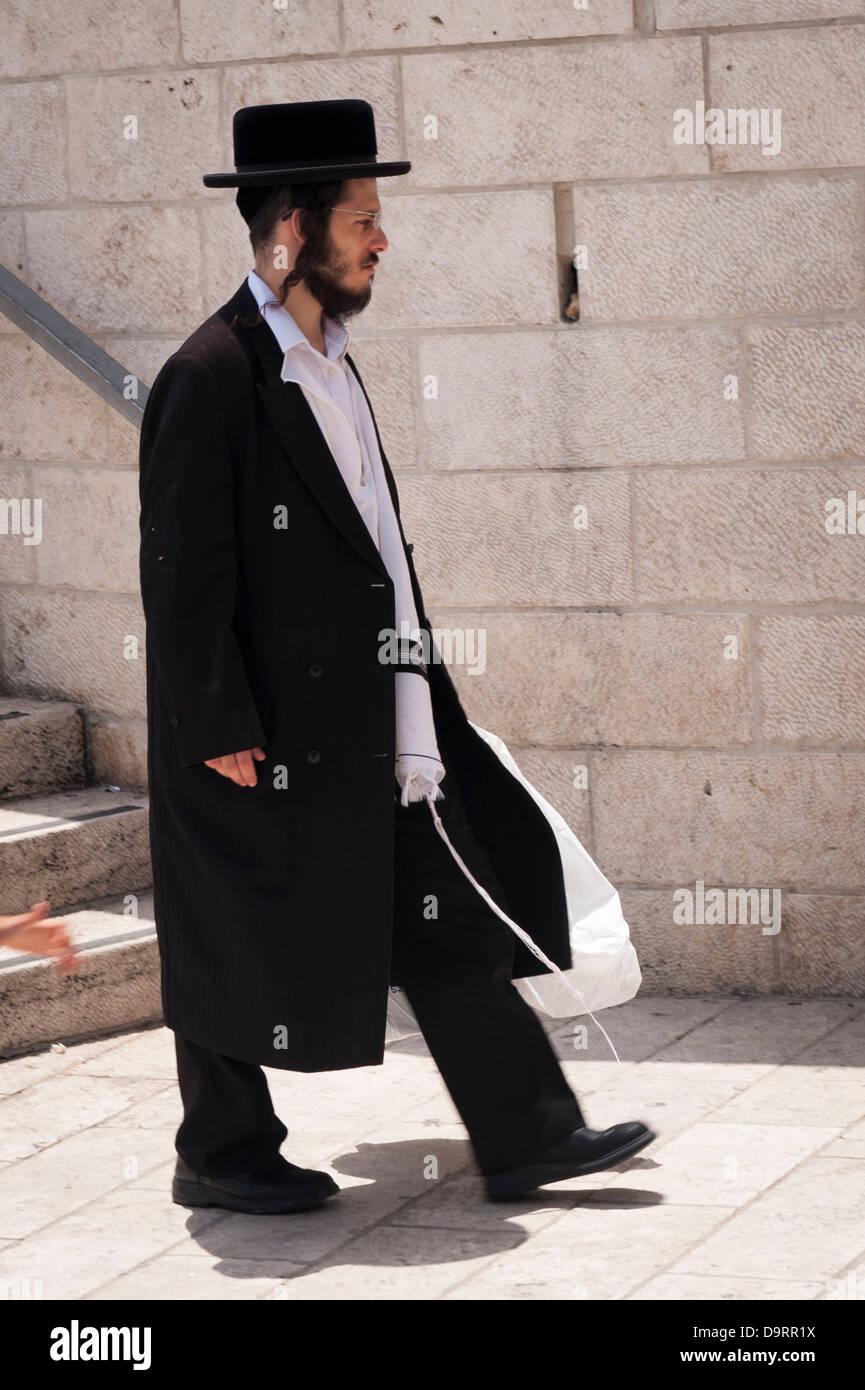Israel Jerusalem Old City Ultra Orthodox Jewish bearded man walking down steps to Western Wailing Wall Ha Kotel Stock Photo