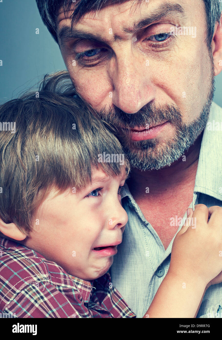 father pities his son - Stock Image