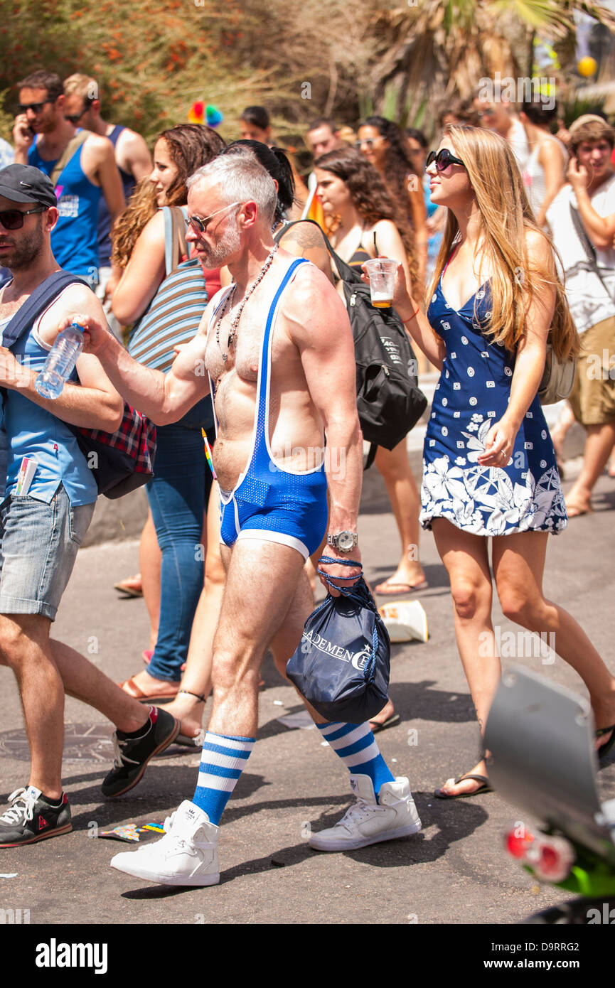 Israel Tel Aviv Gay Pride Day celebrations parade grey gray haired man male blue mankini bathing costume trunks - Stock Image