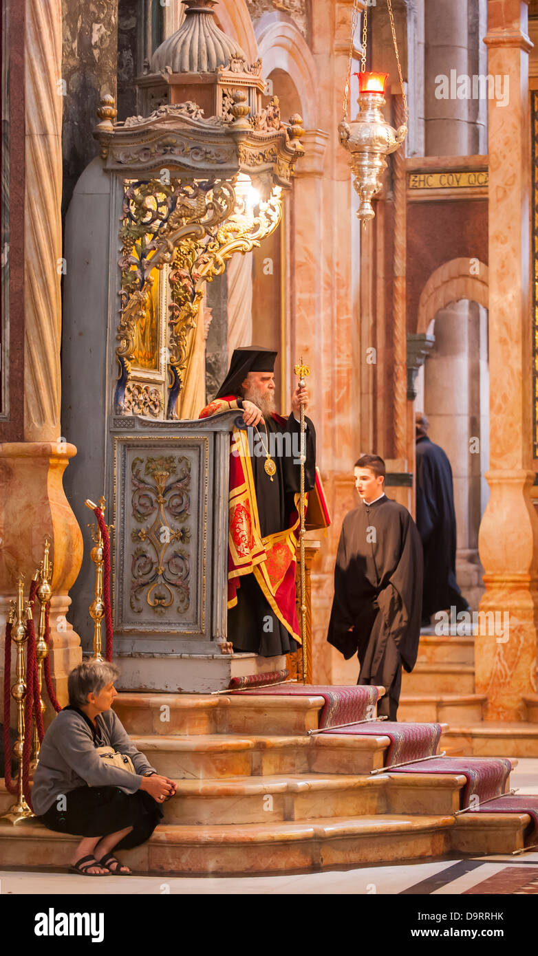 Israel Jerusalem Old City Church of the Holy Sepulchre bearded robed priest minister religious leader seated throne - Stock Image