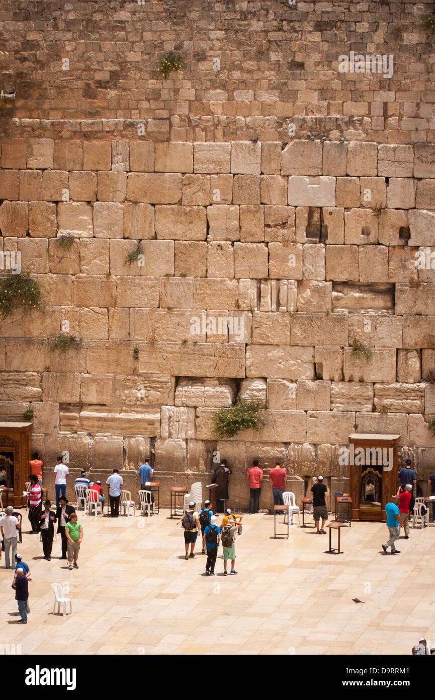 Israel Jerusalem Old City Western Wailing Wall Ha Kotel Plaza mens male section worshipers & young children Stock Photo