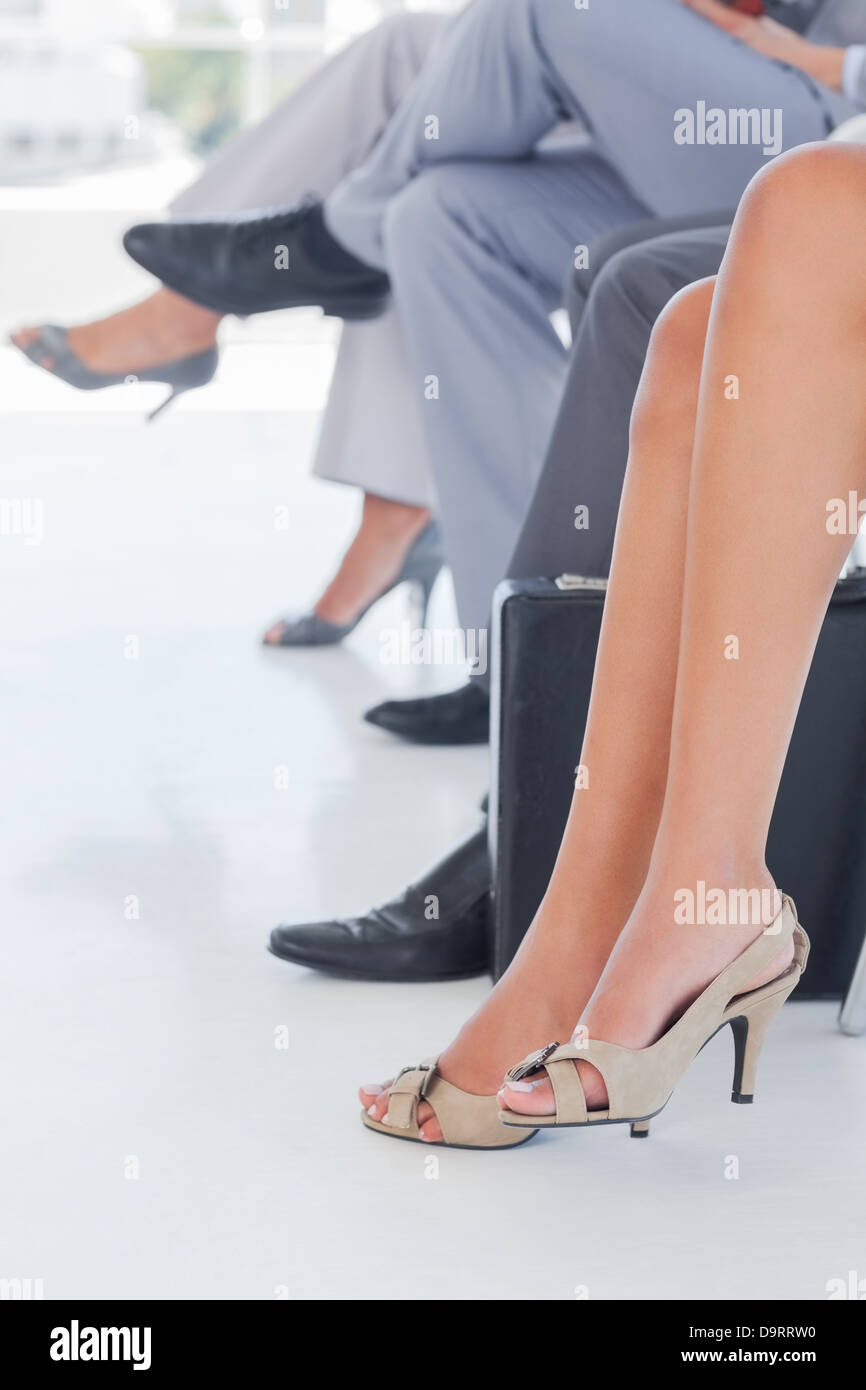 Legs of business people in line - Stock Image