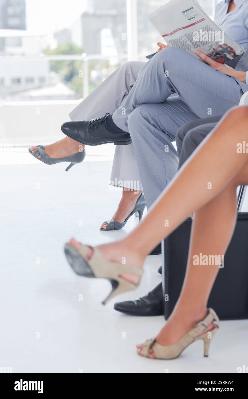 Legs of business people - Stock Image