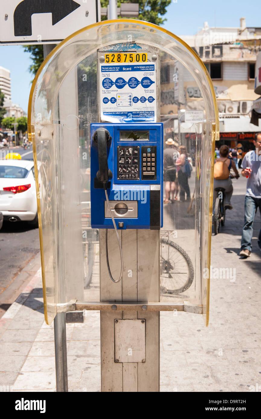 Israel Tel Aviv Jaffa Yofa public telephone perspex booth blue card box kiosk street scene pavement sidewalk - Stock Image