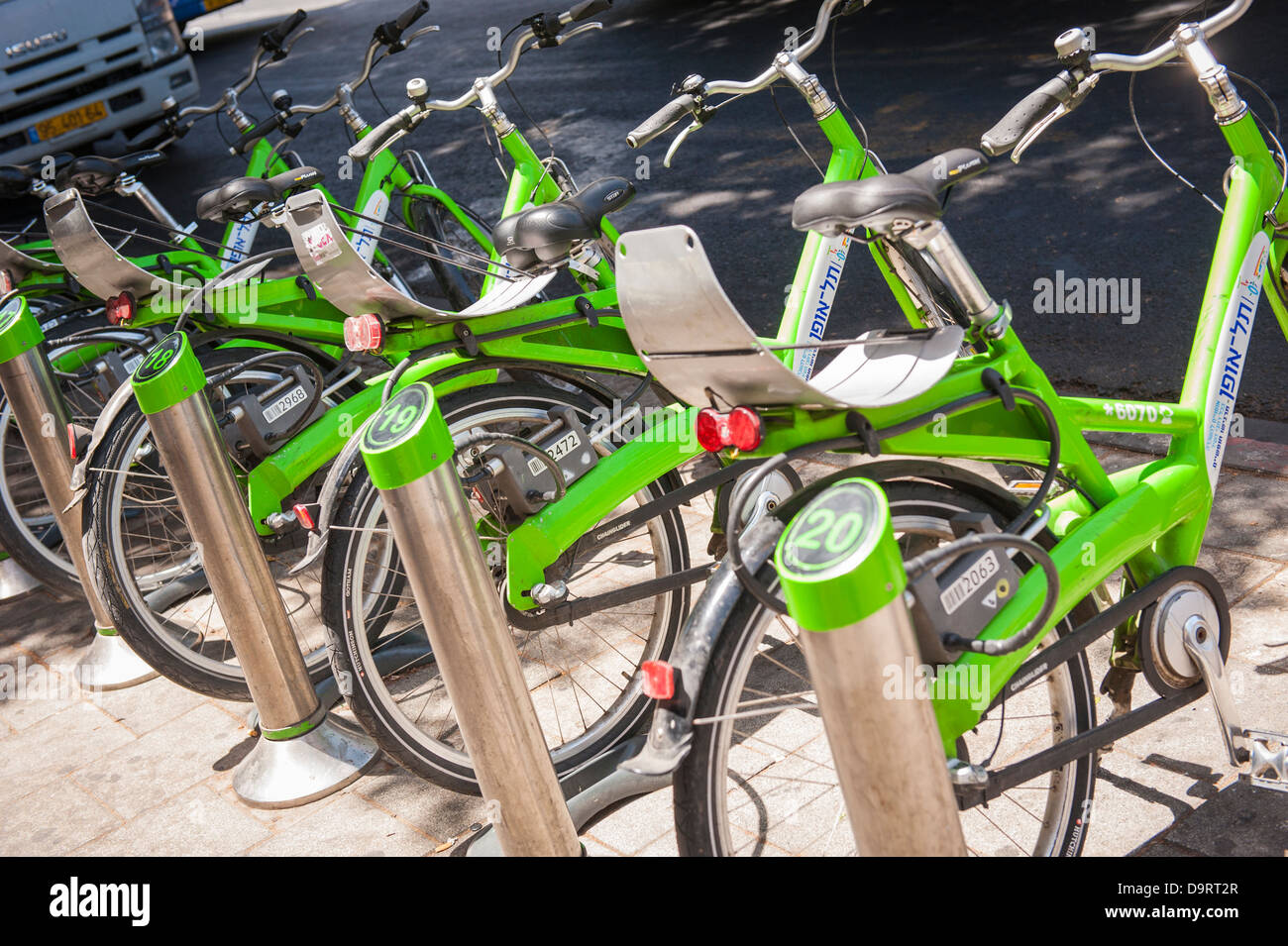 Israel Tel Aviv Tel O Fun bright green self service bike bikes bicycle bicycles hire stand dock docking stands station - Stock Image
