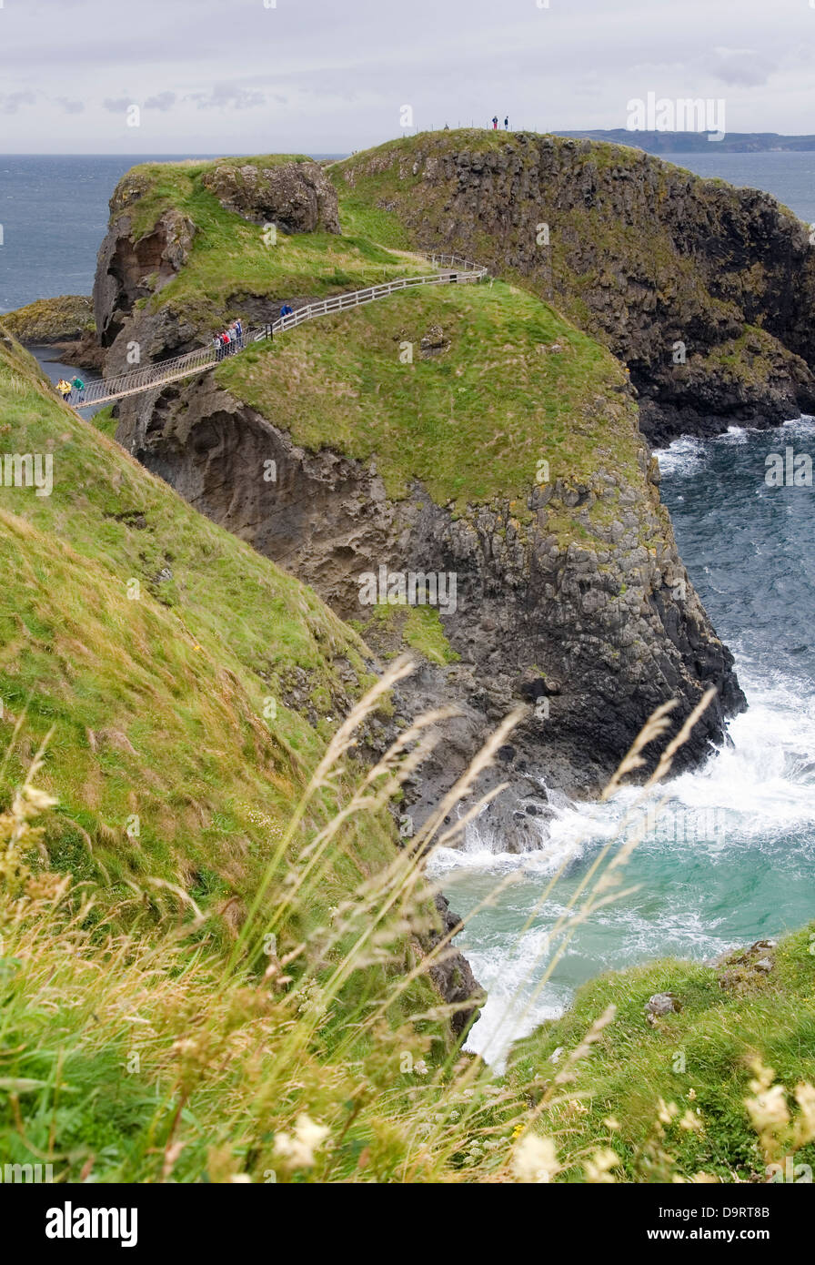 Rope bridge in Carrick-a-Rede, in 'Causeway Route'. Northern Ireland, United Kingdom, Europe. - Stock Image