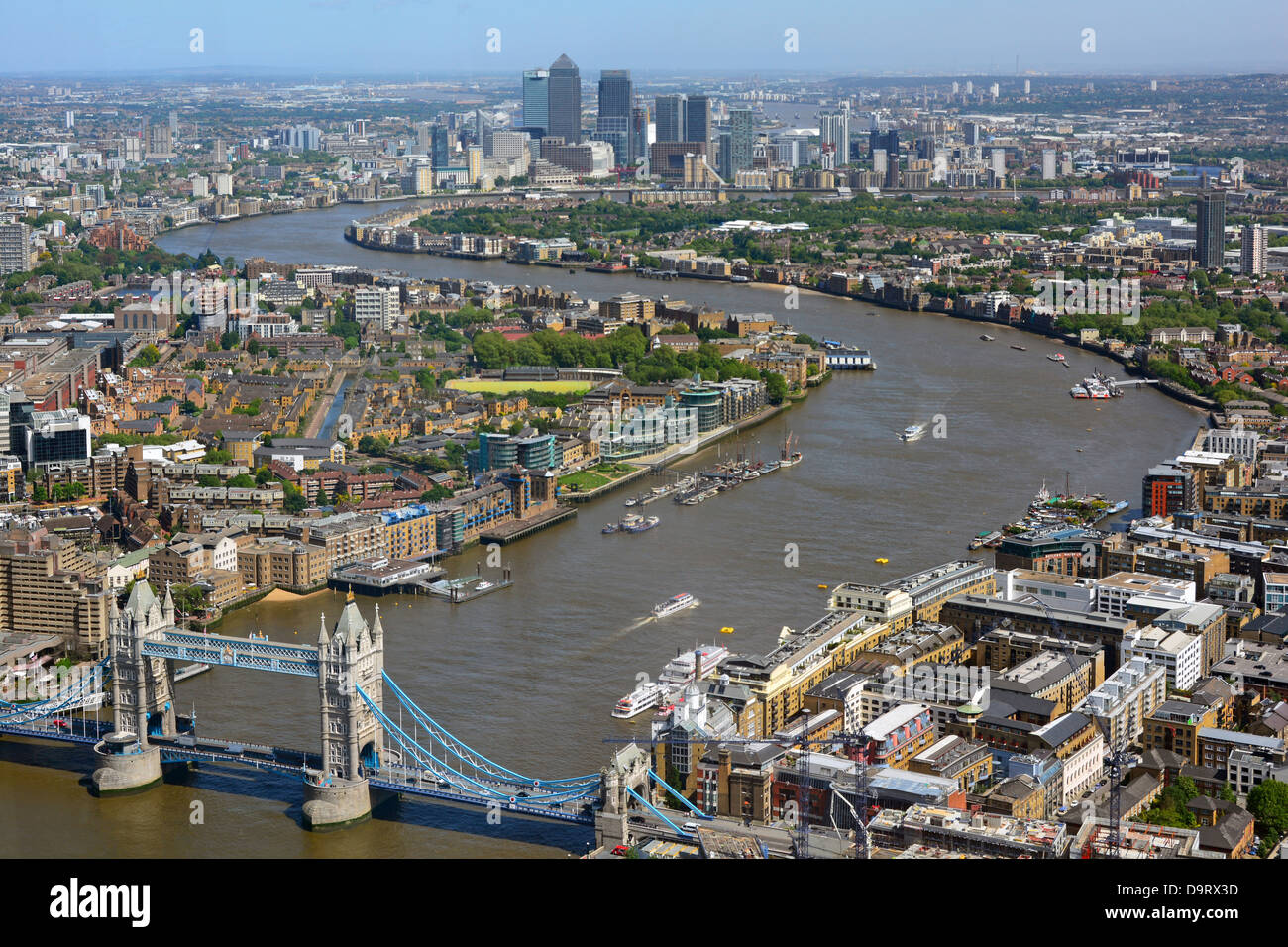 Aerial view of the River Thames from Tower Bridge towards Canary Wharf skyline - Stock Image