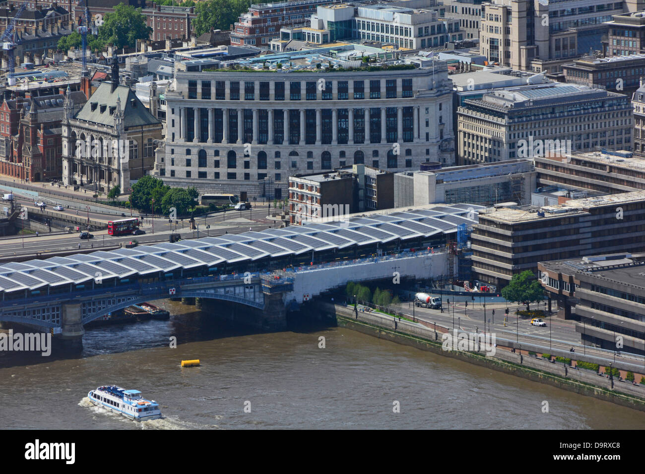 New photovoltaic solar panel roof over new Blackfriars railway station platforms with the Unilever House Building - Stock Image