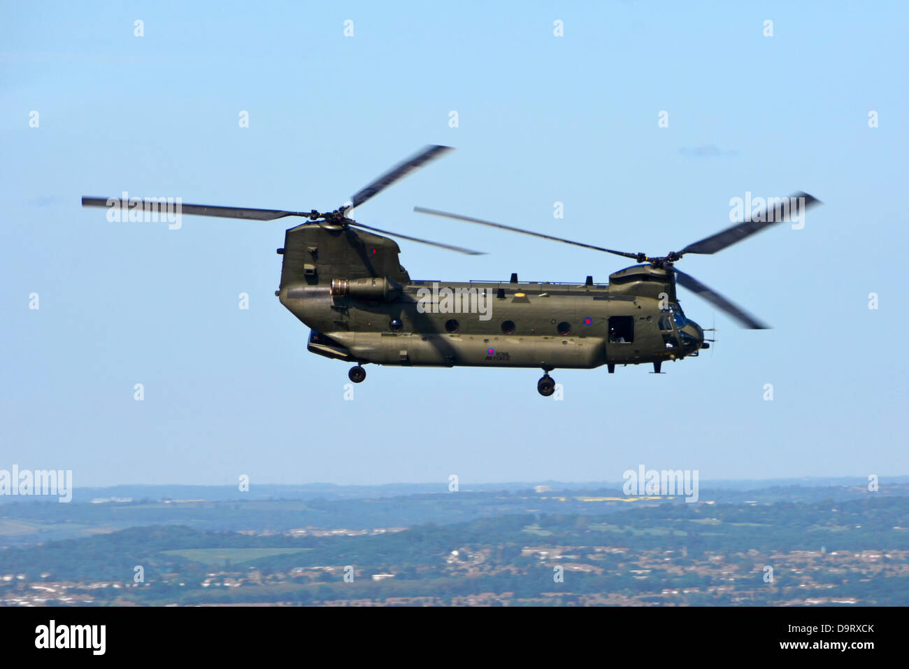Boeing RAF Chinook tandem rotor helicopter flying over the City of London - Stock Image