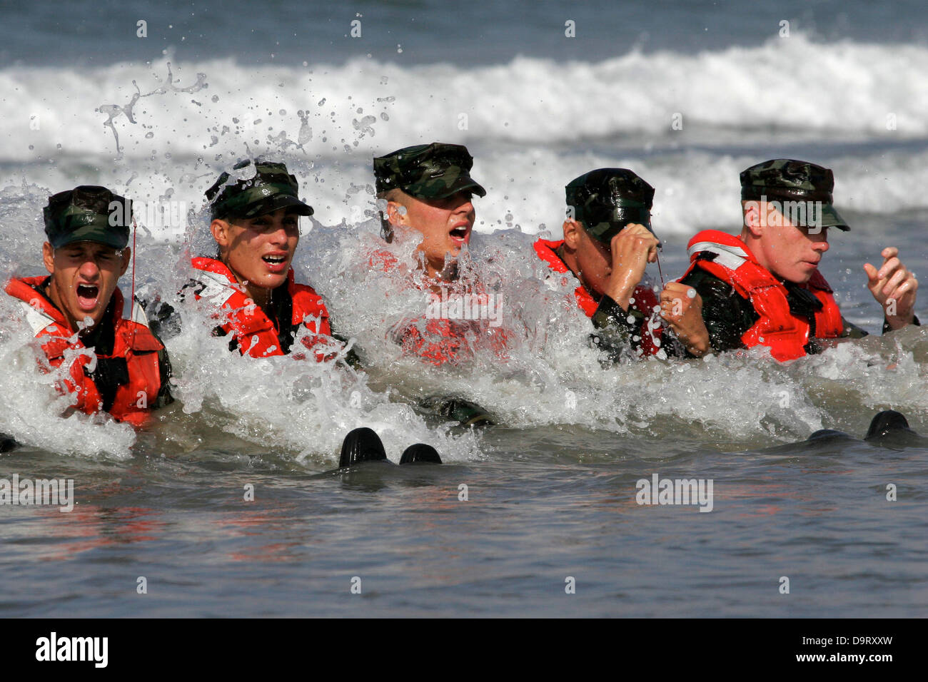 Navy SEAL candidates during surf passage exercises on the first phase of training at Naval Amphibious Base Coronado - Stock Image