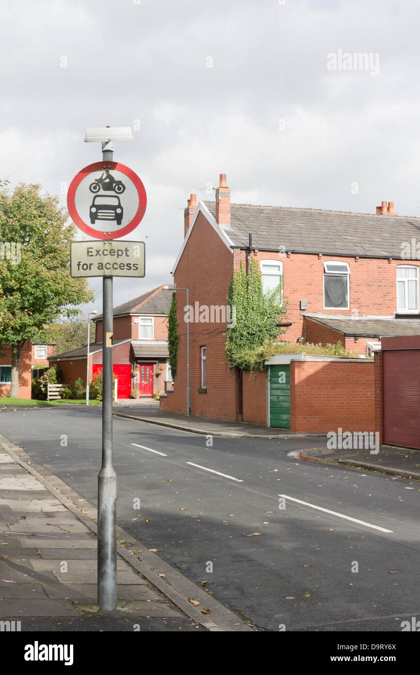 A motor vehicles access restriction road sign on a street, aimed at  preventing a residential road becoming a 'rat - Stock Image