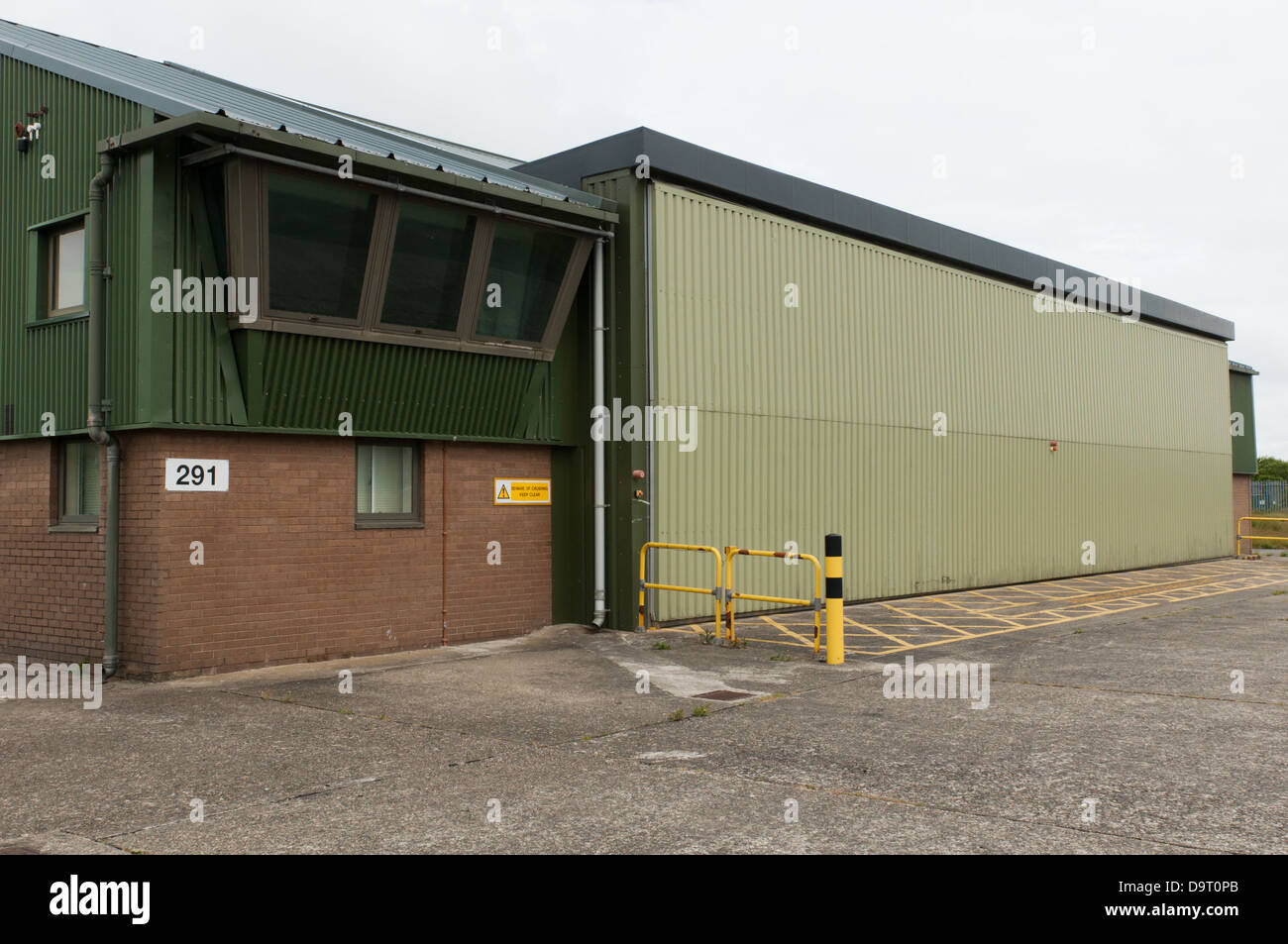 Llanbedr airfield facilities include the old fire section, which was converted to house drone aircraft - Stock Image