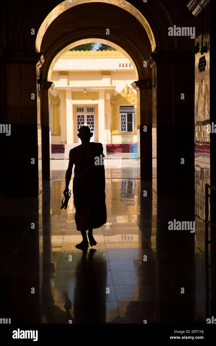 a monk at the ShwenandawKyaung, Mandalay, Myanmar (Burma) Stock Photo