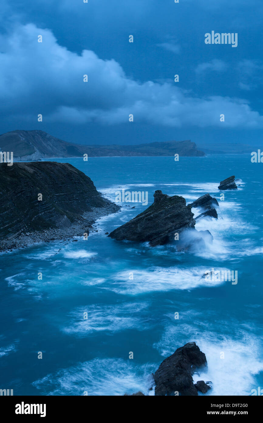 Mupe Bay at dawn on a rough winter morning, Jurassic Coast, Dorset, England, UK - Stock Image