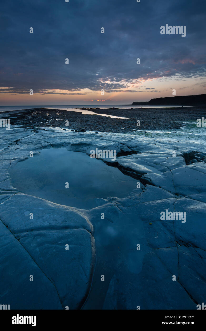 Kimmeridge Bay at dusk, Jurassic Coast, Dorset, England, UK - Stock Image