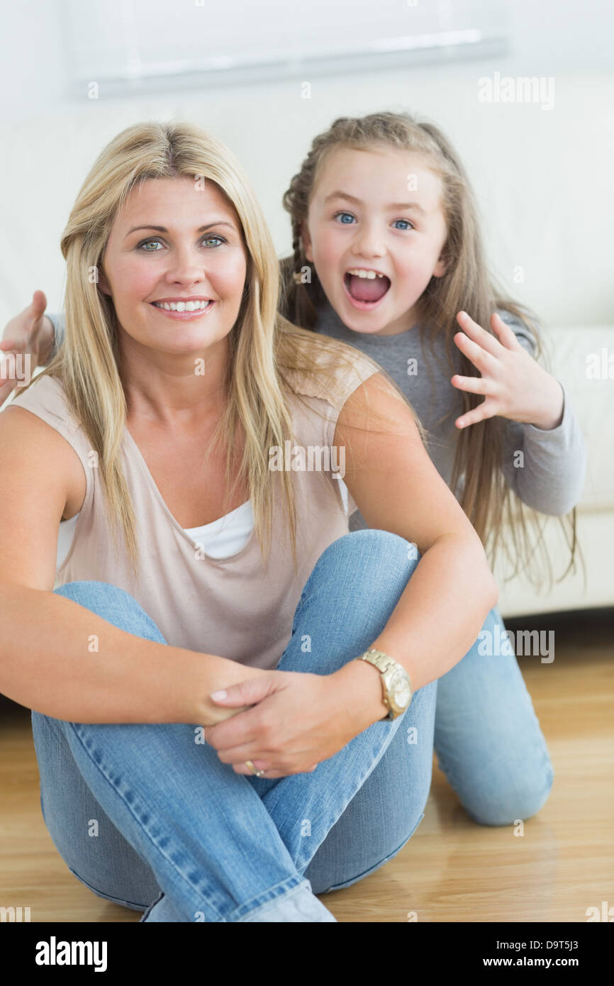 Little girl about to scare her mother - Stock Image